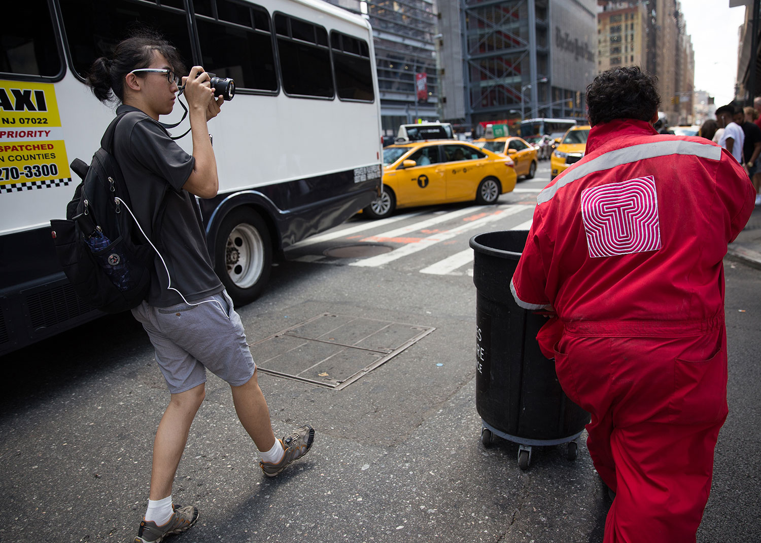 Summer Intensive student taking picture of sanitation working on a Manhattan street