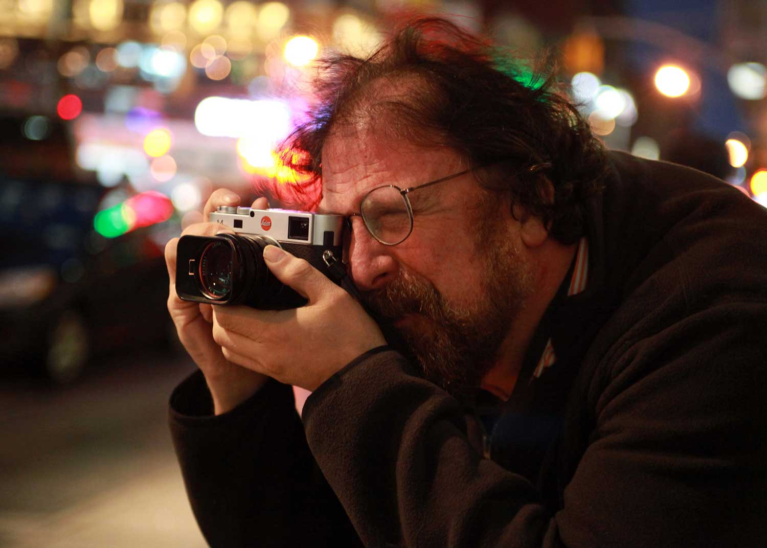 Jim Estrin taking a picture with a point and shoot camera