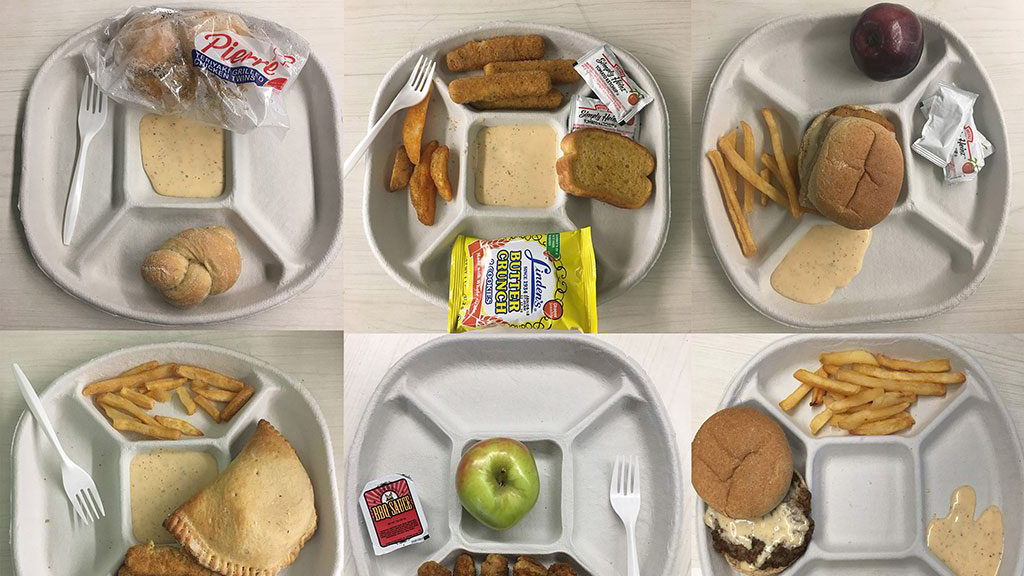 Six public school cafeteria lunch trays with different examples of lunch items like sandwiches and burgers.