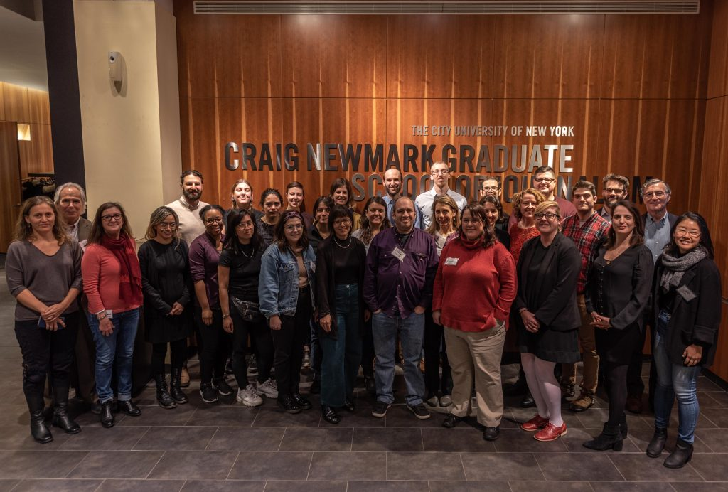 Group photo of the participants of the Reporting the U.S. Workplace winter 2020 program in the lobby of Newmark J-School.